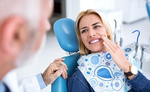 Woman in dental chair during emergency dentistry visit