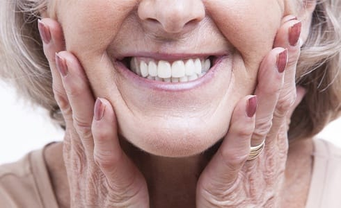 Closeup of smile restored with dental implants